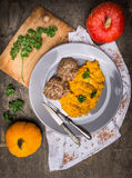 Pumpkin puree with meat patties in plate  on old wooden table Stock Photos