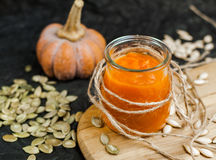 Pumpkin puree smoothies and seeds Stock Photo