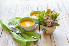 Pumpkin puree soup. Puree soup, made from orange pumpkin, sweet potatoes and carrots, served with sour cream Royalty Free Stock Images
