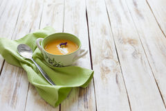 Pumpkin puree soup. Puree soup, made from orange pumpkin, sweet potatoes and carrots, served with sour cream Royalty Free Stock Image