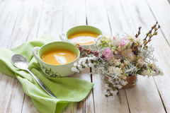 Pumpkin puree soup. Puree soup, made from orange pumpkin, sweet potatoes and carrots, served with sour cream Stock Photo
