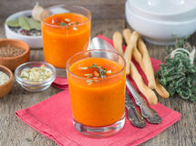 Pumpkin pureed soup in cups Royalty Free Stock Photos