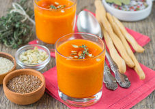 Pumpkin pureed soup in cups. Shallow depth of field Royalty Free Stock Image