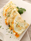 Pumpkin Quesadilla. Delicious pumpkin quesadilla sliced and ready to serve with chopped parsley stock images