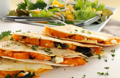 Pumpkin Quesadilla. Delicious pumpkin quesadilla sliced and ready to serve with a garden salad royalty free stock images
