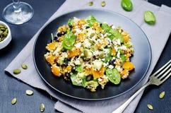 Pumpkin quinoa black beans spinach Feta salad with pumpkin seeds royalty free stock photo