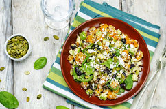 Pumpkin quinoa black beans spinach Feta salad with pumpkin seeds Royalty Free Stock Image