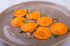 Pumpkin ravioli dish Stock Images