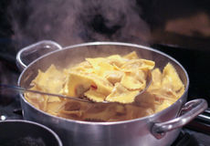 Pumpkin ravioli in hot water. Royalty Free Stock Photography