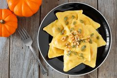 Pumpkin ravioli pasta above view on rustic wood Stock Photos