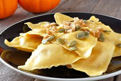 Pumpkin ravioli pasta close up on a black plate Stock Photos