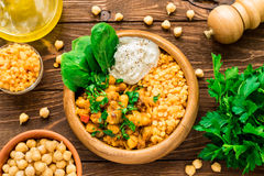 Pumpkin, red lentil, chickpea curry and greek yogurt stock photography