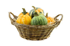 Pumpkin in reed basket isolated on white Stock Photography