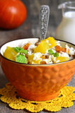 Pumpkin with rice,dried fruits and mint. Stock Photo