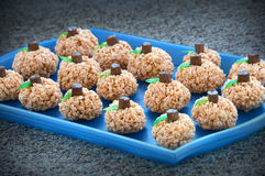 Pumpkin Rice Krispie Treats. Pumpkin shaped rice krispie treats with tootsie roll stems and fruit roll ups cut out to be leaves Stock Photography