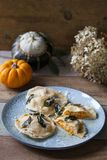 Pumpkin and ricotta ravioli. With crispy sage, burnt butter sauce and parmesan royalty free stock photo