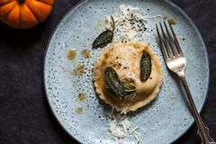 Pumpkin and ricotta ravioli. With crispy sage, burnt butter sauce and parmesan stock image