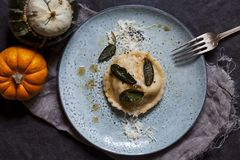 Pumpkin and ricotta ravioli. With crispy sage, burnt butter sauce and parmesan stock photos