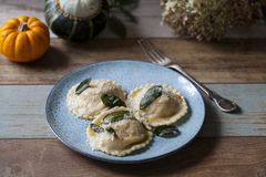 Pumpkin and ricotta ravioli. With crispy sage, burnt butter sauce and parmesan royalty free stock photos