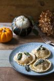 Pumpkin and ricotta ravioli. With crispy sage, burnt butter sauce and parmesan stock images