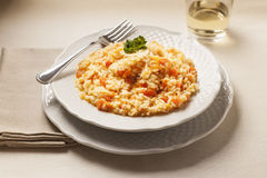 Pumpkin Risotto. On the  table with a glass of wine Royalty Free Stock Photography