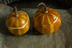 Pumpkin risotto. Baked pumpkin with bolognese, cheese and herbs. Dark background. Selective focus stock photo