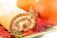 Pumpkin Roll. With Autumn leaves and fresh pumpkins in the background stock photos