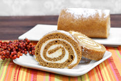 Pumpkin roll cake, selective focus and copy space. Royalty Free Stock Photo