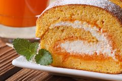 Pumpkin roll with cream cheese macro. Horizontal Royalty Free Stock Photo