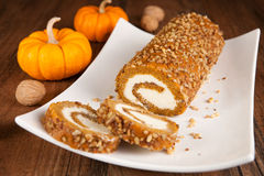 Pumpkin roll. Sliced pumpkin roll on a plate Stock Image