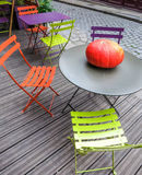 Pumpkin on round table on wooden patio Stock Image