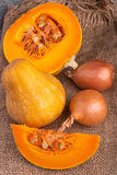 Pumpkin on rustic table and burlap Royalty Free Stock Images