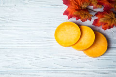 Pumpkin's slices. On the wooden background Stock Photography