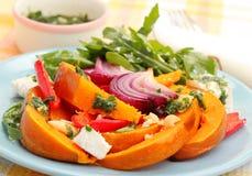 Pumpkin salad. With onion, arugula, feta cheese and pesto Stock Image