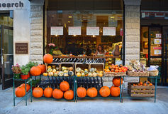 Pumpkin for sale during Halloween in front of store. Pumpkin being displayed outside a store for sale together with Flint corn during Halloween around Little royalty free stock images