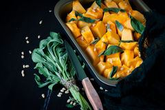 Pumpkin with salvia and pine nuts Stock Photos