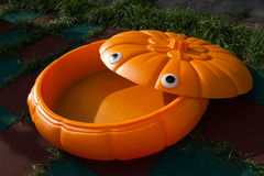 Pumpkin sandbox on a child playground Stock Image