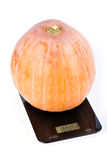 Pumpkin on scales Royalty Free Stock Photography