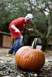 Pumpkin and scary evil clown Royalty Free Stock Image