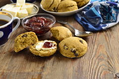 Pumpkin scones with dried fruit, served with jam and butter Royalty Free Stock Photo