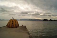 Pumpkin sculpture, Naoshima island. Famous yellow pumpkin sculpture on the shore of Naoshima Island, japanese street art stock images