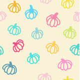 Pumpkin seamless background. Seamless vector pattern of colourful doodle pumpkins Royalty Free Stock Photo