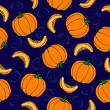 Pumpkin seamless pattern. Blue background. Ripe Vegetable Royalty Free Stock Photo