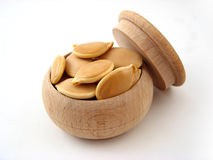 Pumpkin Seed. In wooden pot over white Royalty Free Stock Photo