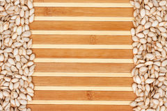 Pumpkin seed  on a bamboo mat Stock Images