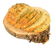 Pumpkin Seed Covered Carrot Bread Bloomer Loaf. Isolated on a white background Stock Photos