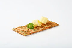 Pumpkin seed cracker with butter Stock Photo