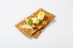 Pumpkin seed crackers with butter and apple Royalty Free Stock Images