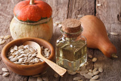 Pumpkin seed oil in a bottle closeup on the table. horizontal Royalty Free Stock Photos