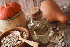 Pumpkin seed oil in a bottle macro on the table. horizontal Stock Photo